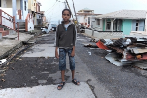 Boy in Puerto Rico amid Maria destruction