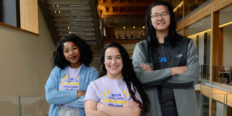 Maria Gallegos (center), a presidential candidate for the ASUO goverment elections, and her running mates, Imani Dorsey (left) and Ivan Chen (right). Mar. 12, 2018. (Madi Mather/Emerald)