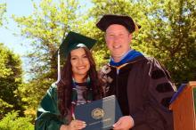 Dr. Daniel Hosang with a 2017 graduate.