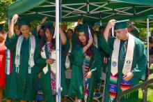 2017 graduates move their tassels, symbolizing receipt of diplomas