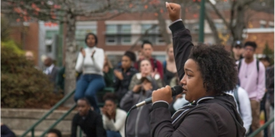 young woman addressing a crowd
